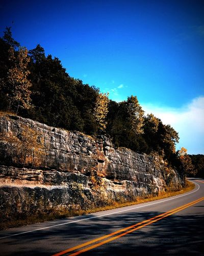 Road Transportation Tree The Way Forward Outdoors Sky No People Clear Sky Nature Blue Landscape Day Cliff Winding Road Beauty In Nature Ozark Mountains Arkansas Beautiful Scenics Blacktop