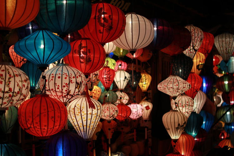 Multi Colored Lanterns Hanging For Sale At Market During Night