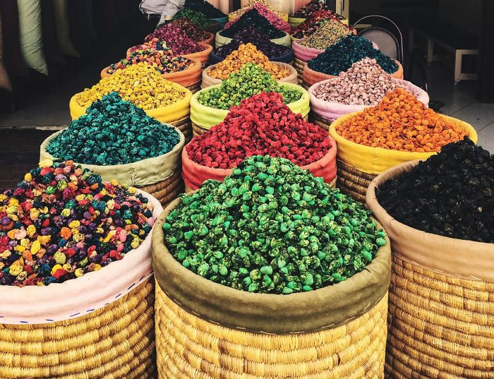 High angle view of colorful spices for sale at market stall