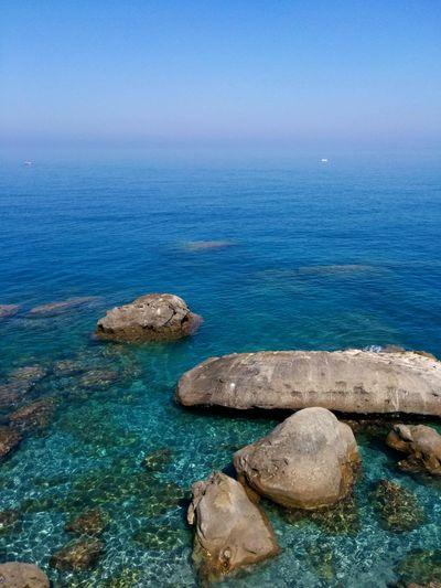 Nello spazio di lontane geografie cavalcando lo Scoglio della Balena Seascape Sicily On The Rocks Scogli Whale Sea And Sky Deep In The Blue Faces Of Summer Crystalline
