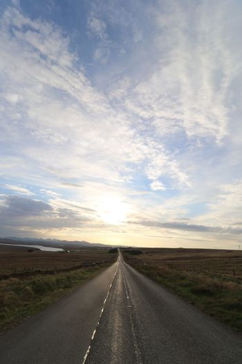 We all walk the long road Nature Sunset #sun #clouds #skylovers #sky #nature #beautifulinnature #naturalbeauty #photography #landscape Isle Of Lewis Outer Hebrides Scotland VisitScotland Sky Cloud - Sky Road The Way Forward Transportation Direction Landscape Environment Diminishing Perspective Nature Tranquility Beauty In Nature Tranquil Scene Scenics - Nature vanishing point No People Field Sunset Land Horizon