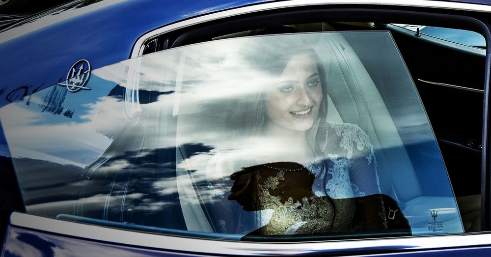 Portrait of woman looking through car window