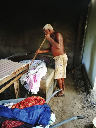 Uncle Indian One Man Only Men People One Person Day Adults Only Outdoors Human Hand Cloth Wok Moving Wood Standing Water Hotting The Stone Bubble Enjoying The Sights Cooking Cloth Kill Bacteria Colourful Clothing Smoking Trolley