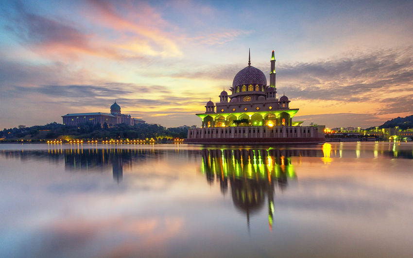 Reflection Architecture Beauty In Nature Belief Building Building Exterior Built Structure Cloud - Sky Dome Government No People Outdoors Place Of Worship Putrajaya Reflection Religion Sky Spirituality Sunset Tourism Travel Destinations Water Waterfront