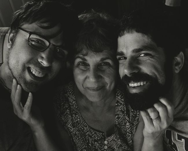Portrait of happy mother and sons at home