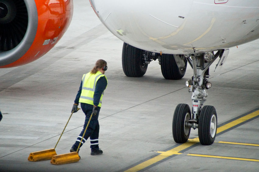 Business Stories Industry Jet Engine Mechanic Plane Transport Transportation Adult Adults Only Aerospace Industry Air Vehicle Airplane Airplane Mechanic Airplane Wing Airport Airport Runway Airport Waiting Airportphotography Commercial Airplane Day Engine Engineer Engineering Expertise Full Length Indoors  Jet Men Mode Of Transport Occupation One Man Only One Person Only Men People Protective Workwear Reflective Clothing Standing Technician Transportation Working The Traveler - 2018 EyeEm Awards