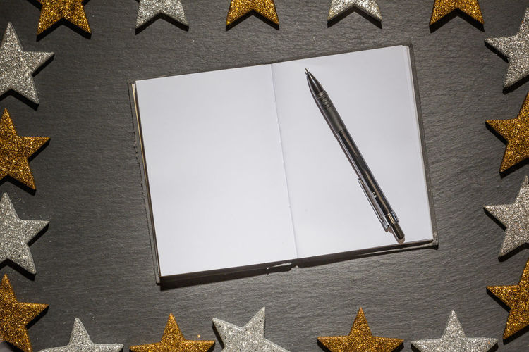 Open diary and pen with new resolutions