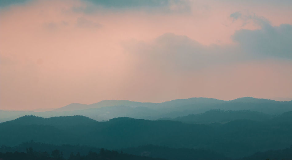 The layered landscape of Chikmagalur.. Travel Blue Layers Hills Orange Variation Earth Chikmagalur Karnataka Travel Destinations Lush Nature Wild Mountain Sunset Fog Silhouette Sky Landscape Multi-layered Effect Weather Mountain Range Atmospheric Mood Sky Only Dramatic Sky Tranquil Scene Foggy