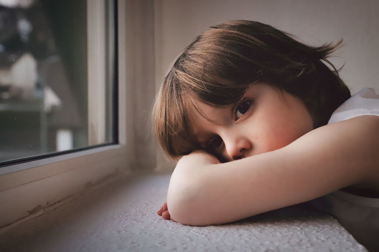 Childhood Child Boy Emotion Emotions Creative Creative Portrait Portrait Portrait Of A Child One Person Indoors  Headshot Window Girls Looking Lifestyles Innocence Sadness Contemplation Home Interior Females Real People Women Depression - Sadness