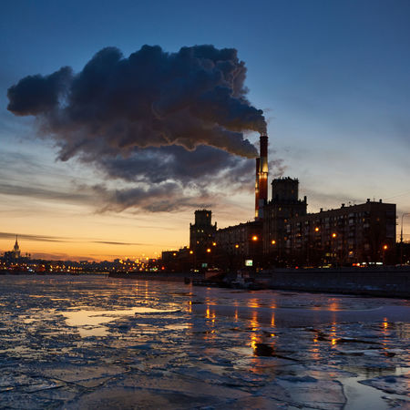 Power Plant on the Moskva River -- As a foreigner I am always surprised to see power plants in operation right in the middle of Russian cities! Floating Ice Ice Moscow Power Plant Russia Smoke Architecture Building Exterior City Cloud - Sky Cold Temperature Dusk Environment Environmental Issues Industry Pollution Sunset Water Winter
