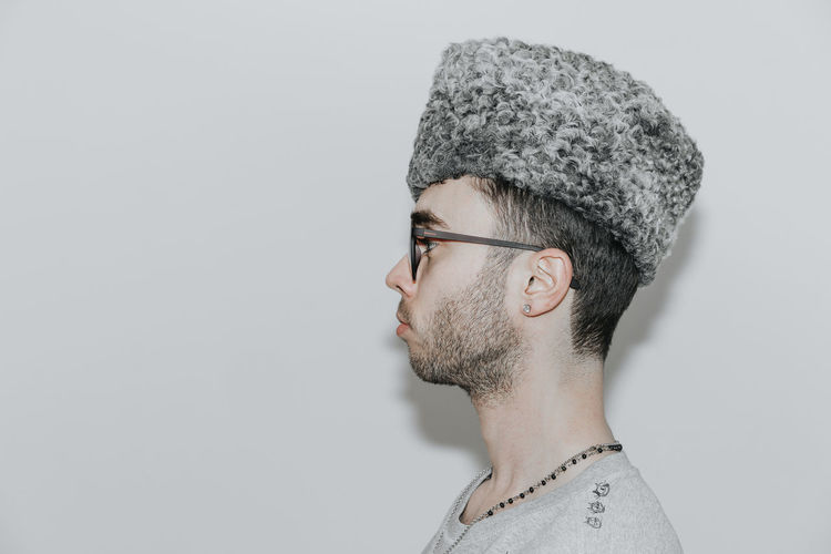 The hat. Portrait Hat Sunglasses Side View One Person One Man Only Young Men Pixelated Intelligence Gray Background Headshot Human Face Individuality Close-up Natural Beauty Eastern European Culture Profile Profile View
