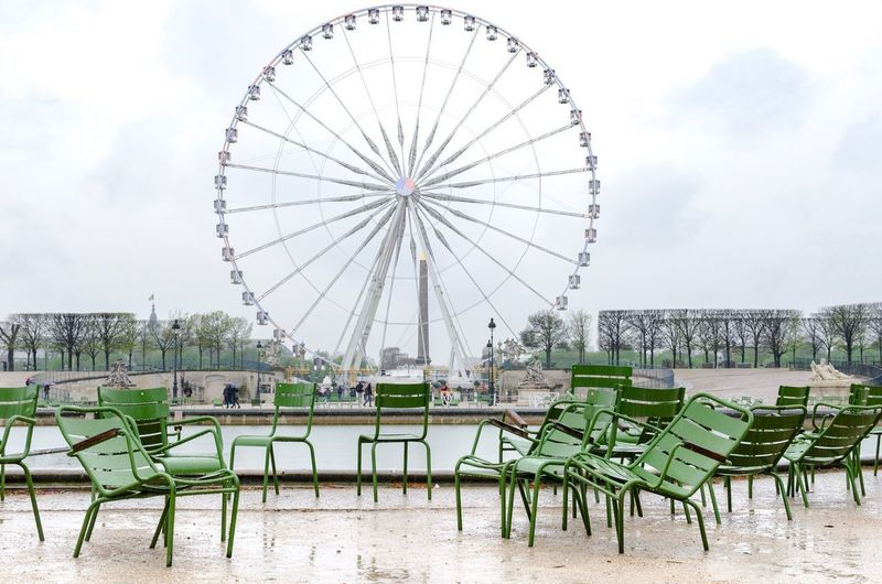 """Be the change you want to be.""Roue de Paris on a rainy day from Tuileries Garden Ride Paris Eye Wheel Of Paris Theme Park Tourism People Travel Weather Gloomy Chaos Confusion Green Chairs Paris Ferris Wheel Sky Raining Rain Rainy Day Ferris Wheel Park Louvre Park Sky Amusement Park Ride Cloud - Sky Ferris Wheel Architecture Chair Arts Culture And Entertainment Outdoors Travel Destinations"