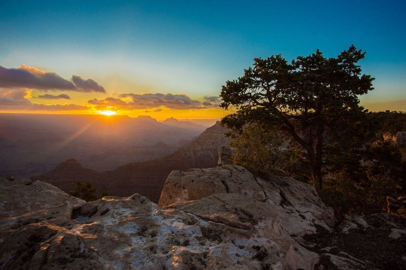 Scenic view of rocky mountains against sky during sunset