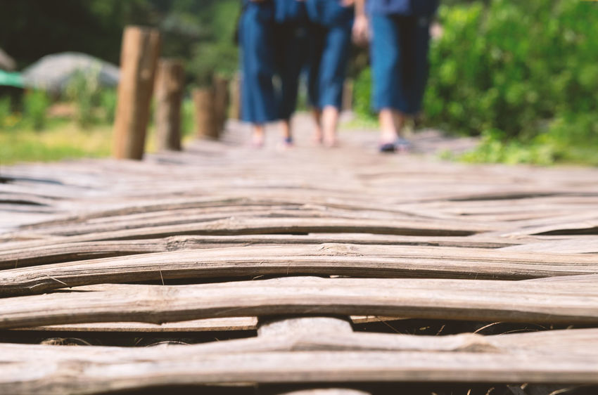 Low Section Day Body Part Walking Nature The Way Forward Direction Plant Human Leg Footpath Lifestyles Focus On Foreground Adult Selective Focus Sunlight Outdoors People Real People Tree Surface Level Blurred Background Foreground Rural Countryside Woven Bamboo