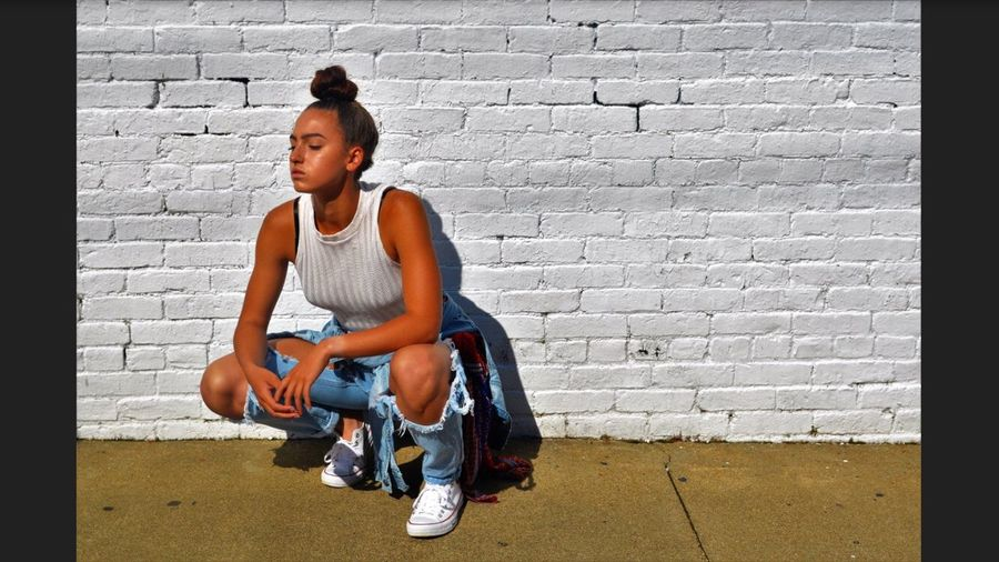 L•O•S•T Brick Wall One Person Full Length Casual Clothing Only Women People One Woman Only Real People One Young Woman Only Young Adult Day Outdoors Adult Adults Only Campellsville Beauty Lifestyles Jeans Blank White Background Fashion Adults Only White Photo Photography