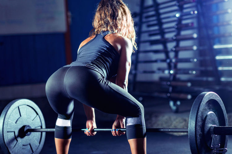 Woman Weightlifting on Training Training Healthy Fitness Gym Exercise Body & Fitness Weight Health Woman Fit Athlete Workout Muscular Young Female Sport Lifestyle Muscle Strength Strong People Athletic Bodybuilding Adult Endurance