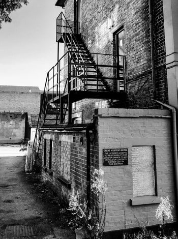 fire escape Photowalktheworld Blackandwhite Black And White Photography Oneplusphotography Mobile Photography Urban Exploration Urban Exploring Water Steps And Staircases Fire Escape Emergency Exit Emergencies And Disasters Exit Sign Staircase Hand Rail Steps Stairs Stairway