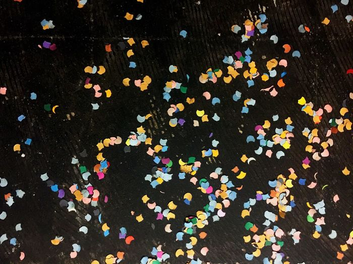 Confetti Celebration Multi Colored Studio Shot Party - Social Event Fun Large Group Of Objects Enjoyment Black Background Paper No People Close-up Food Aftermath Party Decoration Pattern Indoors