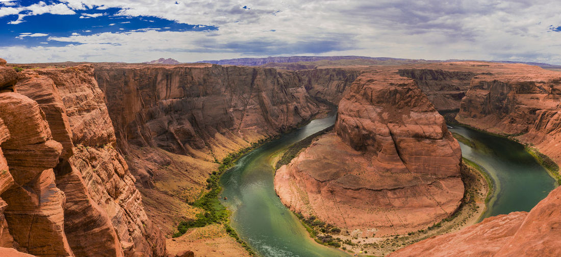 The horseshoe bend near page in the us state of arizona on a summer day with lots of colors