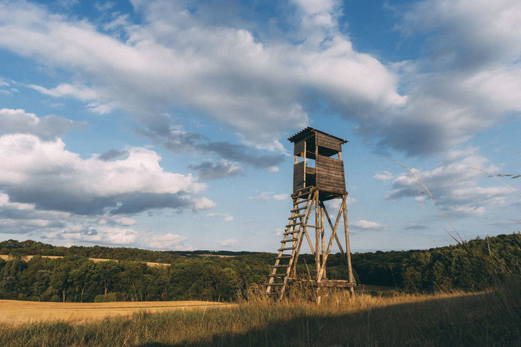 Look out. Hunter Thuringen Thuringia Architecture Beauty In Nature Built Structure Cloud - Sky Day Environment Field Grass Land Lookout Tower Nature No People Observation Point Outdoors Perching person Plant Scenics - Nature Sky Storage Tank Thüringenentdecken Tower