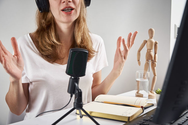 Midsection of woman doping podcast