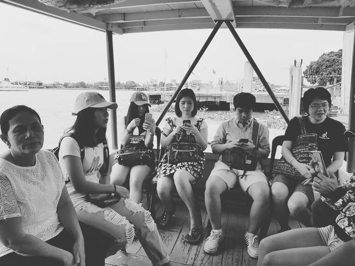 Boat ride People Waiting Sitting On A Bench Sitting Boat Boat Ride Transportation Transport Commuting People Using Mobile Black And White Street Photography Mode Of Transport Snapshots Of Life Strangers Storytelling Street Portrait The Week On Eyem