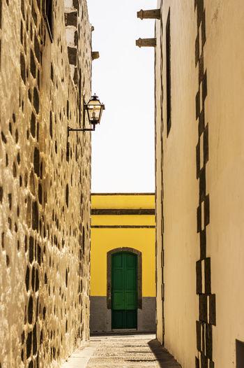 Corridor of building against clear sky