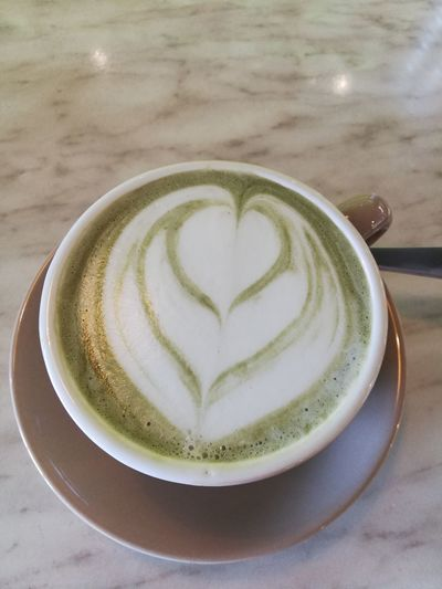 Lovely cup of matcha latte with a tinge of yellow light reflection Latte Photography ArtWork Green Green Green!  Art, Drawing, Creativity Arts Culture And Entertainment Latteartgram Latte Heart LatteOftheDay Latte Art Heart Matcha Latte Matchalove Matchagreentealatte Matcha Green Tea Froth Art Cappuccino Frothy Drink Drink Latte Matcha Tea Coffee - Drink Love Coffee Cup Heart Shape Saucer Hot Drink Froth Tea Cup Beverage Served Foam