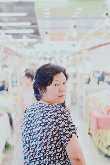 Portrait Of Woman Standing In Shopping Mall