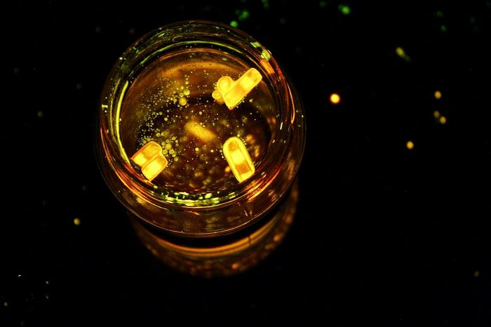 Close-up Illuminated Night Lights Lights In The Dark Glowsticks Glow In The Dark Indoors  No People Playing With The Light Long Exposure Longexposurephotography Floating On Water New Perspectives Happyness Jar Of Lights Jar Like Stars