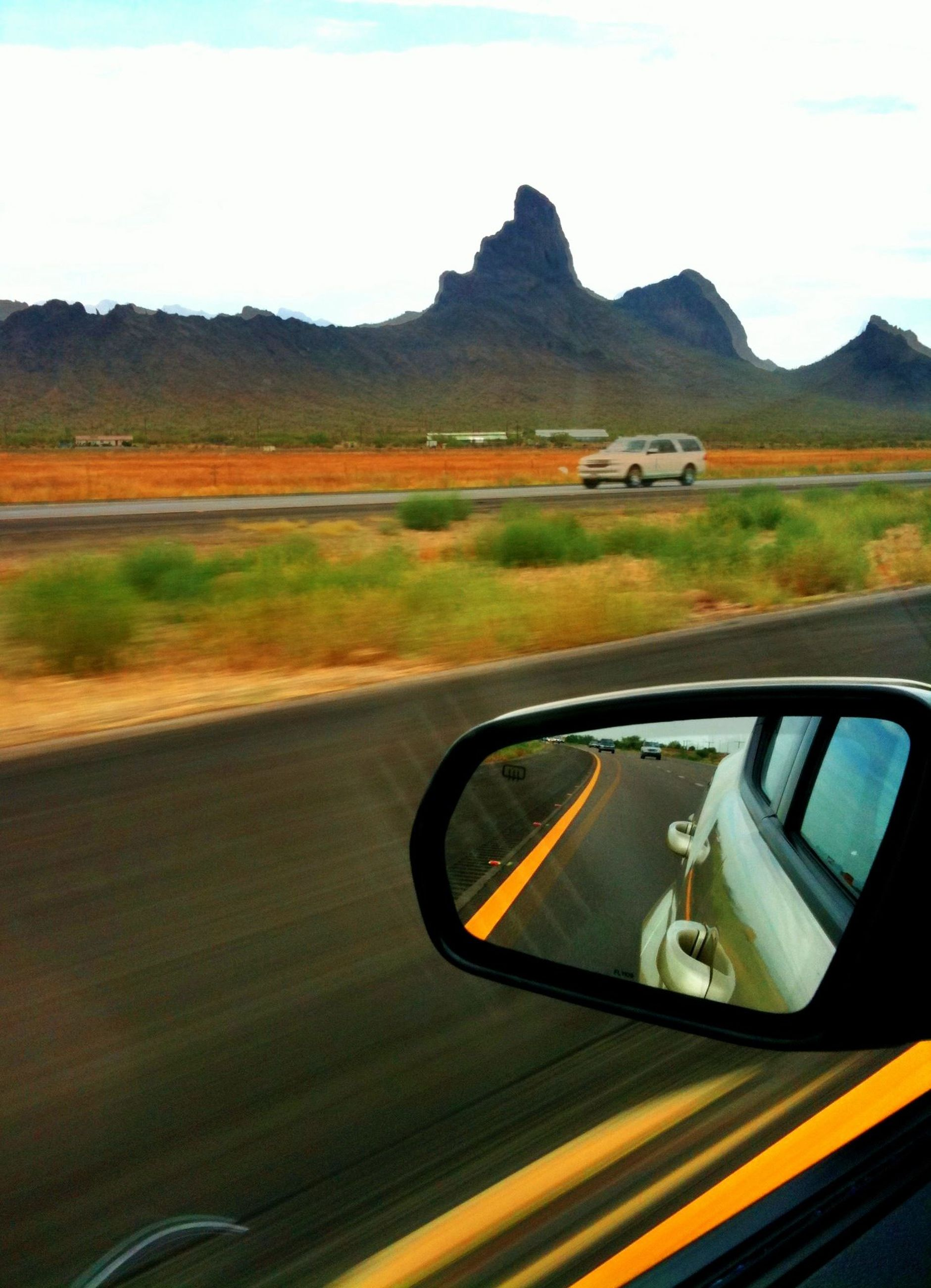 transportation, land vehicle, mode of transport, car, landscape, side-view mirror, road, mountain, vehicle interior, travel, sky, car interior, cropped, part of, reflection, on the move, field, sunset, road trip, scenics