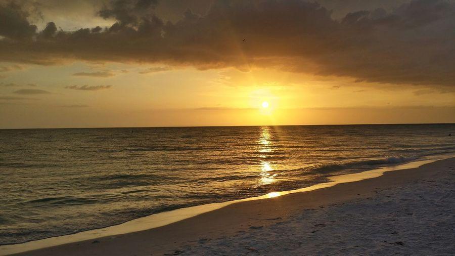 Idyllic shot of orange sunset sky over sea