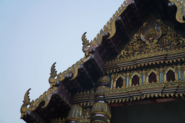 Thai Temple In Gaya Architecture Art And Craft Belief Buddhist Temple Building Building Exterior Built Structure Clear Sky Creativity Day History Low Angle View No People Ornate Outdoors Place Of Worship Religion Sculpture Sky Spirituality Statue The Past