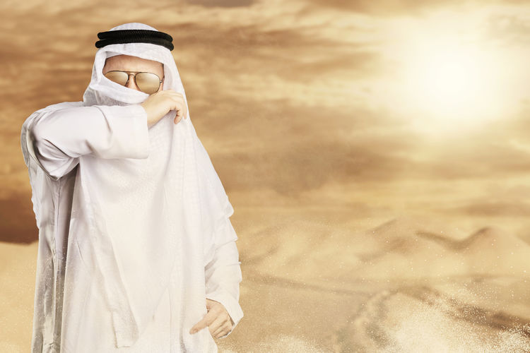 sheik protect with keffiyeh from desert storm in front of sunlight Arabian Desert Hot Sheik Sunlight Tourist Arab Desert Storm Dune Keffiyeh Landscape Nature Outdoors Protect Sahara Sand Sand Dune Scarf Shaik Sun Glasses Sunshine Tourism White