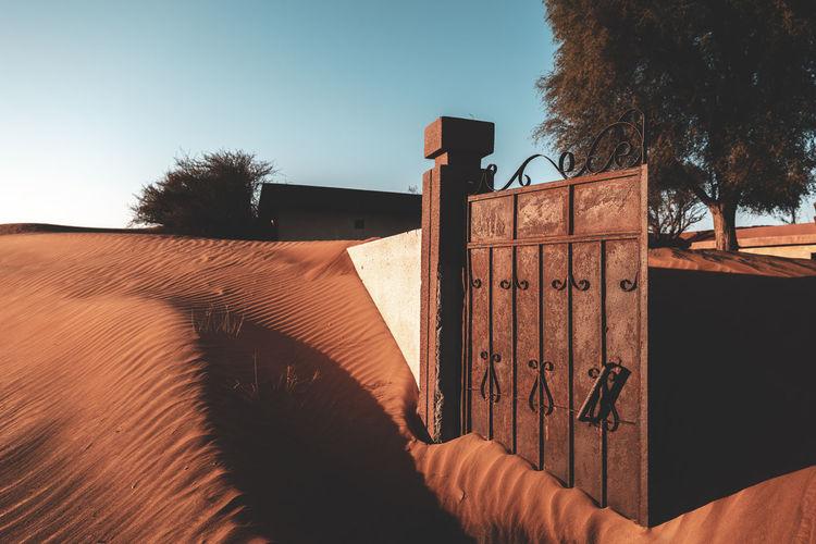 Rusty gate in desert ruins