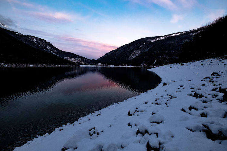 sunset in Molveno Snow Cold Temperature Sky Winter Scenics - Nature Water Tranquil Scene Beauty In Nature Tranquility Mountain Nature Cloud - Sky No People Lake Non-urban Scene Mountain Range Idyllic Environment Snowcapped Mountain