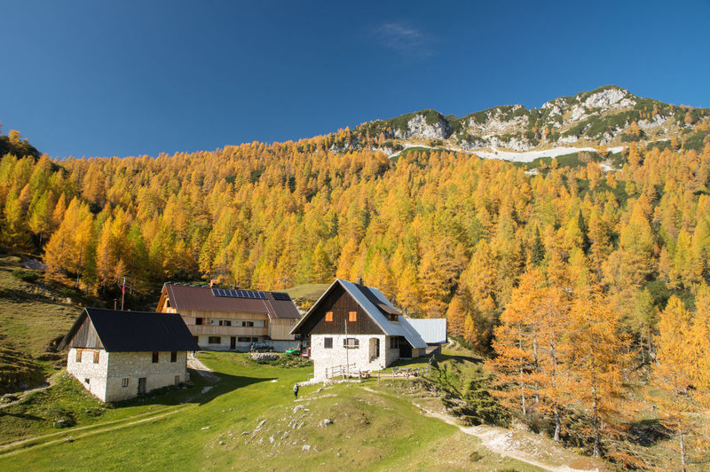 Autumn in Julian Alps in Slovenia Architecture Built Structure Building Exterior Plant Mountain Autumn Building House Land Scenics - Nature Tree Nature Sky Landscape Residential District Day No People Environment Beauty In Nature Forest Change Outdoors Cottage Slovenia Autumn