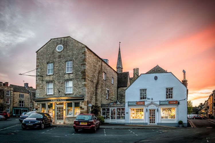 Square in Stow on the Wolds at sunset Architecture Building Exterior Built Structure City City Life City Street Cloud Cloudy Cotswolds Day Dusk Land Vehicle Mode Of Transport No People Outdoors Parked Parking Parking Lot Pink Place Road Scenics Sky Square Sunset