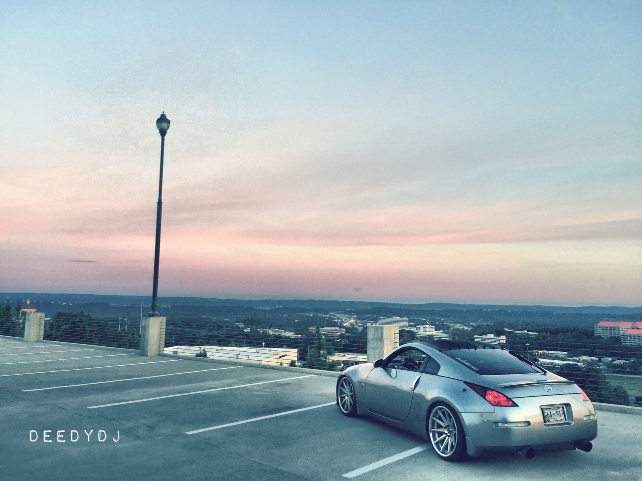 transportation, car, road, no people, street light, mode of transport, sky, built structure, land vehicle, outdoors, day, architecture, horizon over water, nature