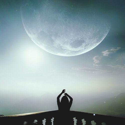 Man against moon at night