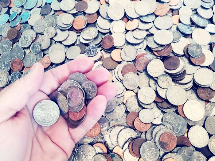 Cropped hand of woman holding coins