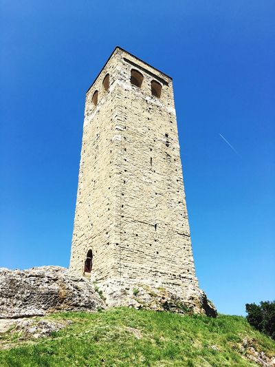Architecture Low Angle View Tower Built Structure Day Clear Sky Guidance Grass Building Exterior Lighthouse Blue Outdoors No People Nature Sky Montefeltro San Leo Belltower