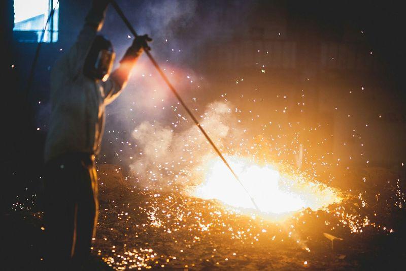 Man melting iron at factory