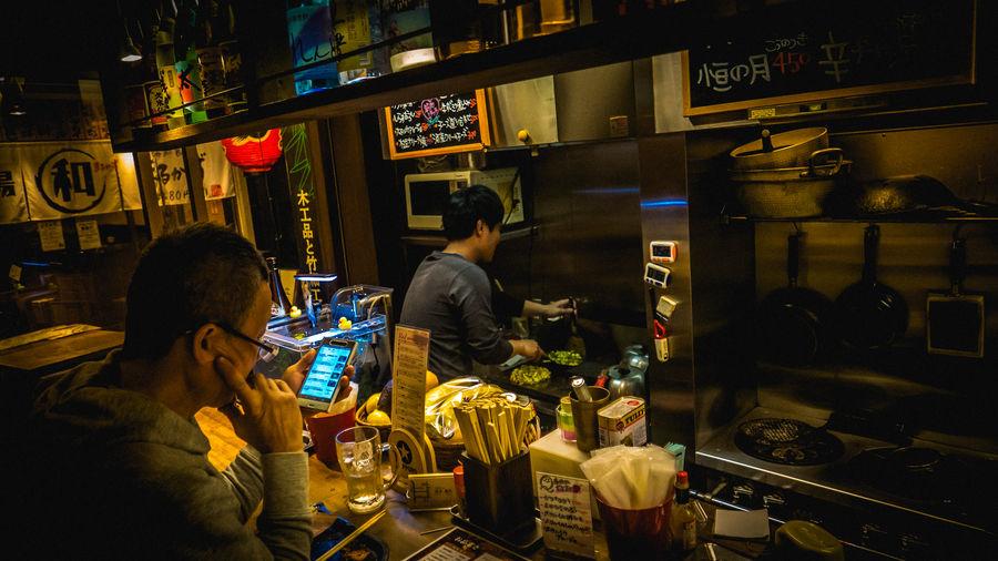 Adult Cafe Food Food And Drink Illuminated Indoors  Japan Japan Photography Nightlife Okonomiyaki People Real People Restaurant Working