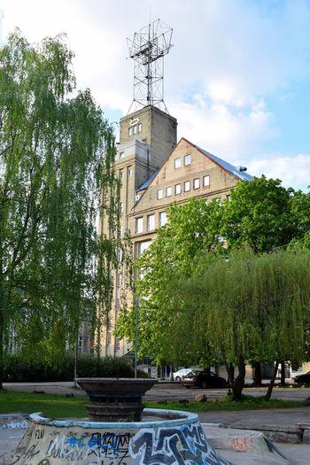 Architecture Building Exterior Built Structure City Cloud - Sky Contrast Day Graffiti Green Color Latvia Latvija Nature No People Old Buildings Outdoors Riga Riga Latvia RigaCity Rigaphotos Skatepark Sky Tower Tree VEF VEF Tower