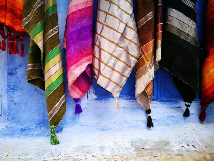 Colorful textiles hanging on wall