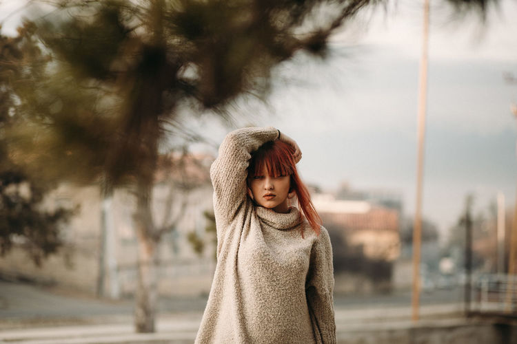 One Person Clothing Portrait Focus On Foreground Women Standing Young Adult Tree Hair Sweater Waist Up Day Nature Casual Clothing Looking Winter Headshot Brown Hair Hairstyle Contemplation Outdoors Warm Clothing Wrapped In A Blanket Beautiful Woman Turtleneck