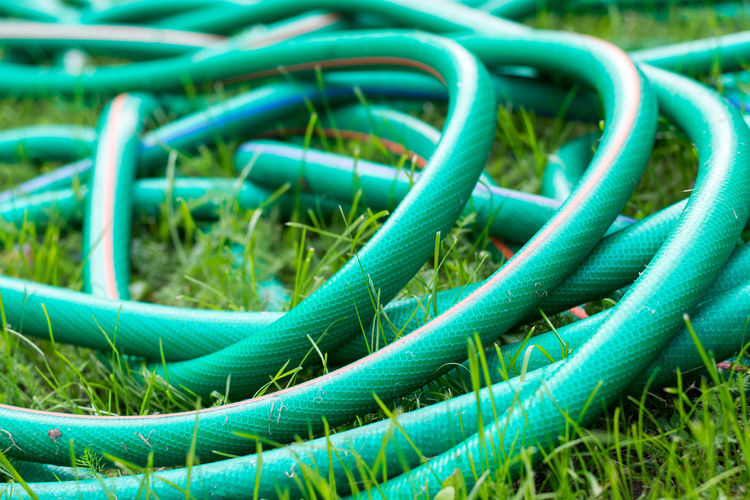 Backgrounds Cable Close-up Complexity Connection Curled Up Day Equipment Field Full Frame Garden Hose Grass Green Color Land Nature No People Outdoors Pattern Plant Rope Tangled