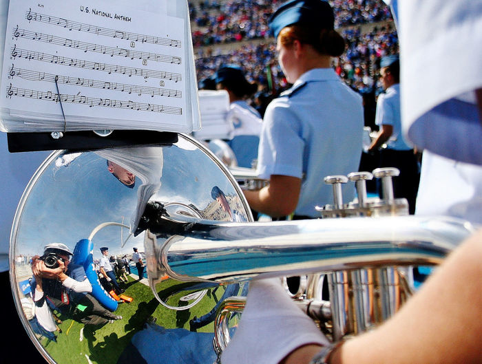 A marching band prepares to play the US National Anthem prior to an American college football game. American Football National Anthem The Photojournalist - 2018 EyeEm Awards Adult Casual Clothing College Football Day Group Of People Holding Incidental People Leisure Activity Lifestyles Marchingband Men Musical Instrument Outdoors People Real People Rear View Reflections Uniform Women
