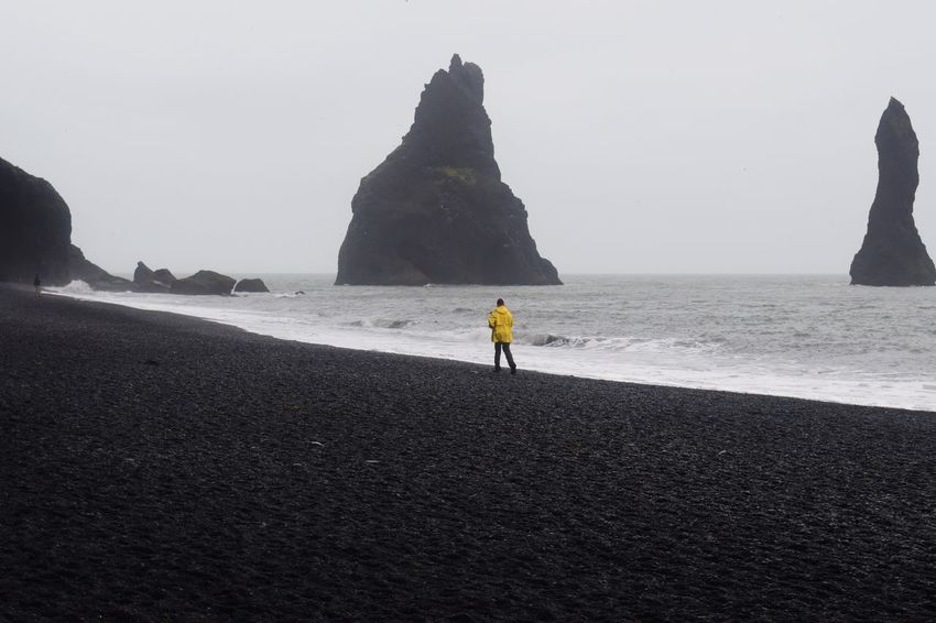 Black Sand Beach - Vik Iceland Vik Iceland Vík í Mýrdal Beach Beauty In Nature Black Rock Beach Black Rocks Black Sand Beach Iceland Clear Sky Iceland Beach Leisure Activity Lifestyles Nature One Person Outdoors People Real People Rear View Rock - Object Rock Formation Sand Scenics Sea Tranquility Vik Go Higher